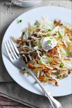 """Delicious hash browns, topped with Greek yogurt, scallions, and """"everything"""" seasoning. Serve along side eggs or all on its own!"""