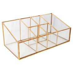 • Rich glass construction<br>• Clear design with brilliant gold highlights<br>• 6 organizational compartments<br>• Ideal on countertops or in vanity drawers<br>• Wipe clean with dry cloth<br><br>Keep your beauty essentials close-at-hand with a Glass and Metal, 6 Compartment Vanity Organizer. Compact enough to keep your vanity clean and free from clutter or small enough to fit into a drawer. The perfect balance of beauty and function.