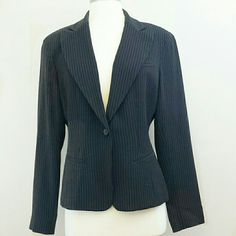 Black pinstriped single button blazer Black pinstriped single button blazer.  Fully lined.  72% triacetate, 27% polyester,  1% other fiber.  Lining is 100% acetate. Jones New York Jackets & Coats Blazers
