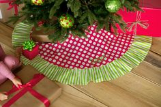 """Choose the personalized Ikat tree skirt for you or a friend this Christmas season. The 48"""" in diameter round skirt is 100% cotton. The tie secures around the base of the tree. Monogram/Name included"""