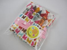 Butterfly Crayon Organizer Roll  Argyle and Beautiful by adrisadorables on Etsy, $10.00  Would make cute party favors!