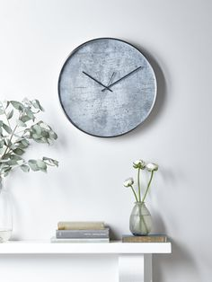 Encased in a simple brushed silver effect case with matching silver hands and an elegant, cement effect face, our statement wall clock will make the perfect addition to your home office or living room. With a smooth, silent sweep rather than a tick, it also makes a wonderful bedroom clock.