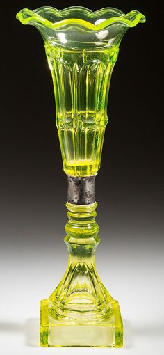 "PRESSED BIGLER VASE, bright canary yellow (uranium), deep conical bowl with a gauffered and tooled 10-petal rim, raised on a double-knop stem, octagonal baluster-form standard and square base, wafer construction. Boston & Sandwich Glass Co. and/or Mt. Washington Glass Works. 1840-1860. 12 1/4"" H, 4 1/2"" DOA rim, 3 1/8"" SQ base."