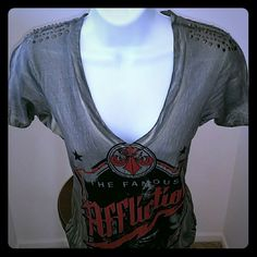 Affliction T-shirt NWOT Deep V-neck, made of 100% cotton done in a grey brush bleach wash . The front has the logo sublime /graphics live fast logo designe.New without tag. Affliction Tops Tees - Short Sleeve