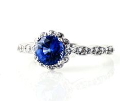 Check out LoveItSoMuch.com to discover unique products like 14K Blue Sapphire Engagement Ring with Diamond Halo Custom Bridal Jewelry.