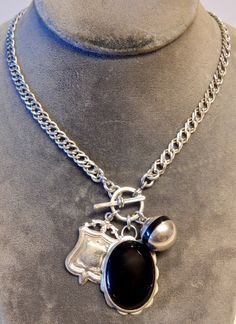 Vintage sterling silver double curb chain with sterling watch fob, onyx pendant and vintage enamel and sterling ball.