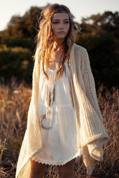 Hippie in the wheat grass field....cute outfit.