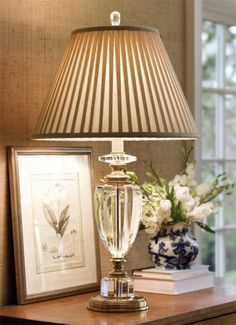 Crystal lamp is pretty, but I'd definitely change this pleated shade.