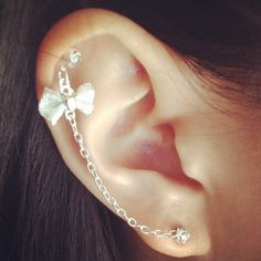 Earring with attached bow cartilage earring