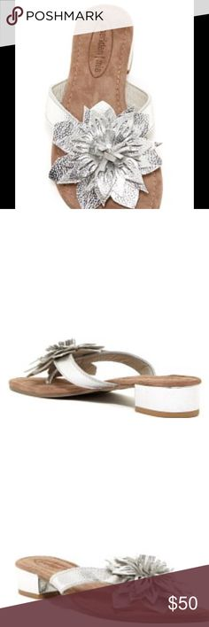 Sassy Floral Chunky Silver Sandals Thing toe. Leather construction. Floral vamp. Lightly padded suede footed. Chunky block heel. Approximate 1.25 heel.  Imported. Materials:  Leather Upper and man made sole. Sheridan Mia Shoes Sandals