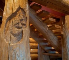 A pair of bear's relief carved as a subtle detail on the stairs, by Pioneer Log Homes of BC