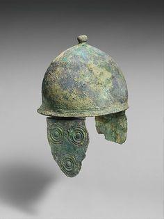 Bronze helmet with cheek-guards; mid-4th century B.C., Late Classical; Culture: Etruscan; Medium: Bronze