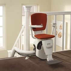 Thyssen Flow II Curved Stairlift for narrow stairs, supplied and installed by Dolphin Lifts UK.