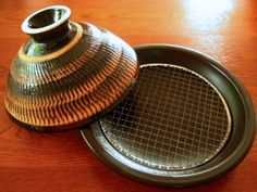 Tagine-style donabe (Japanese ceramic pot) made with premium grade clay by one of the best donabe makers in Iga, Japan. The Fukkura-san is a versatile pot, suitable for a wide-range of cooking styles.