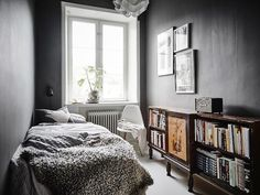Dark grey walls in the guest bedroom of a stunning Swedish apartment in neutrals. Entrance / Jonas Bergstedt.