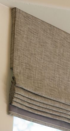 Tailored linen roman shade.