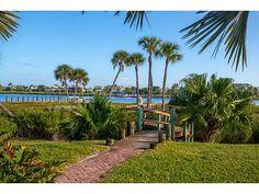 RIVERFRONT HOME IN GATED ISLAND COMMUNITY.  8060 SEACREST DRIVE, VERO BEACH, FL 32963