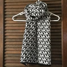 """Michael Kors Signature Scarf New.  White with black, all over MK signature.  Reverses to black with white signature.  Measures 64""""x10"""".  100% acrylic.  No trades or Paypal. Michael Kors Accessories Scarves & Wraps"""
