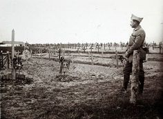 A Viscount in the Armoured Cavalry Branch of the French Army has left a collection of hundreds of glass plates taken during World War One that have never been published before. The images, by an unknown photographer, show the daily life of soldiers in the trenches, destruction of towns and military leaders. Above, a French officer stands near a cemetery with recently dug graves of soldiers killed on the frontline at Saint-Jean-sur-Tourbe on the Champagne front, eastern France December 19…