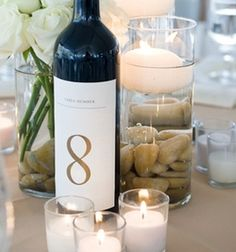 Wine Bottles as Table Numbers then everyone at the table gets a glass of wine... Might have to do this, saves money!