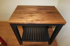 Black Butcher Block Kitchen Cart with Walnut Top by McClure Tables.