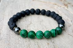Check out this item in my Etsy shop https://www.etsy.com/uk/listing/470877372/green-malachite-black-lava-rock-stone