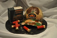 hunting cake - the hat is a vanilla butter cake, the shell box is a chocolate cake with edible images. Shells are made from gumpaste.