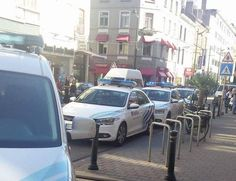 A woman has been shot by police after she launched a knife attack on bus…