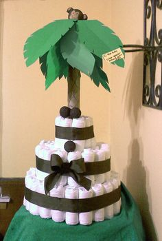 Monkey in a palm tree Diaper Cake! Perfect centerpiece or gift for a baby shower. Cute safari jungle party theme.