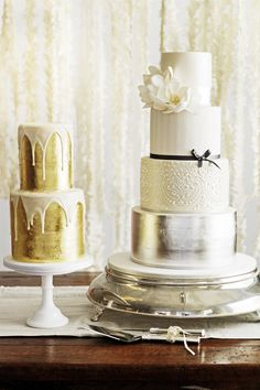 White, silver and gold wedding cakes