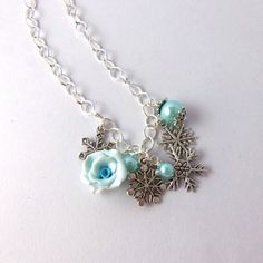 Turquoise pearl and polymer clay rose by FayeValentine on Zibbet