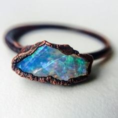 So beautiful! Indie and harper copper and opal ring by reva