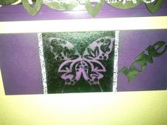 Handmade wall art:  bottom of an old dresser drawer spray painted and stenciled.