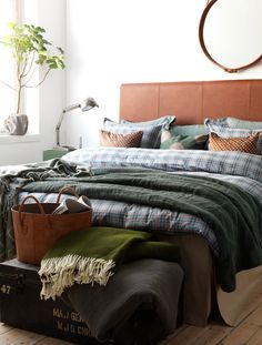 Cozy bedroom. Blue, brown and green. Rustic.