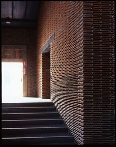 8 B Nave / Arturo Franco  wall built from terracotta roof tiles