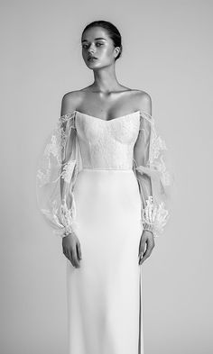 RITA wedding dress by @livne.white is truly a modern bride's dream. Chic and elegant with touch of whimsy, this elegant fitted corset wedding gown with a twist features oversized sheer lace and tulle sleeves, a high slit skirt and a structured lace top. Sleeve game on point! #LivneWhite #AlonLivne #Ad #Wedding #WeddingDress #WeddingGown #Bridal #WeddingDresses #WeddingGowns #ChicBride #ModernBride #IllusionSleeves #Sleeves #LivneWI #Engaged #Romantic #BohoBride #Lace #WeddingInspiration