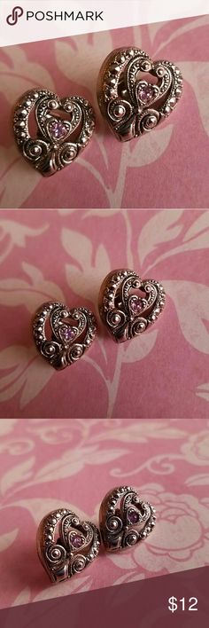 Vintage Avon Victorian heart earrings silver tone This pretty pair of vintage Avon earrings is heart shaped, each with an Amethyst purple colored rhinestone in the middle of a Victorian style setting. Signed AVON on the backs. In excellent vintage condition with minimal wear. From a smoke free home :)  BEARA8875Avon888 Avon Jewelry Earrings