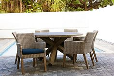 The 7 Piece Indo Round Dining Set will change the way you think about your outdoor space. This stunning collection is exclusive to patio plus. It includes six dining chairs and one round dining table. The dining chairs are made using an all-weather resin wicker with beautiful wood legs. The round, wooden dining table compliments the dining chairs perfectly. This collection is available in two different Sunbrella cushion colours and works well with the Indo 4 Piece Lounge Set.