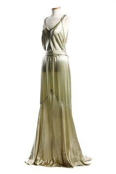 Light green satin evening dress, c. This stylish gown with a magnificent Art Deco design rhinestone ornamentation on the back was worn by the donor's sister, Eleanor Middleton Rutledge Hanson for her second court visit at Buckingham Palace in Front 1930s Fashion, Moda Fashion, Art Deco Fashion, Vintage Fashion, Vestidos Vintage, Vintage Gowns, Vintage Outfits, Vintage Clothing, Green Satin Dress