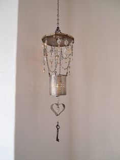 Wind chime upcycled with a vintage key, tin can, crystals, etc.