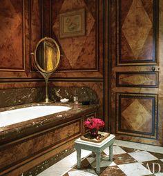Anne McNally's Paris apartment bathroom with a marble tub.