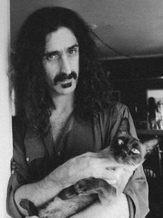 Frank Zappa, why am I not surprised his cat is cross-eyed?