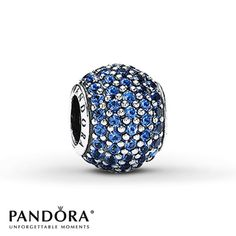 This lovely sterling silver charm from the PANDORA Moments Holiday 2012 collection is awash with sparkling round blue crystals. Style # 791051NCB.