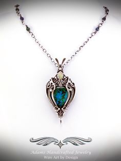 New custom piece. Version of my 'Victorian Rose' heart design in .999 fine silver with a chrysocolla & a faceted Ethiopian welo opal. Original design by Daryl Adams.