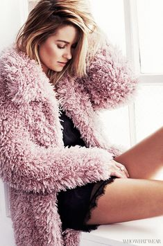 Lauren Conrad wear a chunky faux fur pink coat over a slip, and shows off her messy bob // Photo by Justin Coit