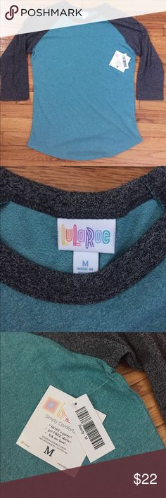 NWT Lularoe Randy baseball 3/4 tee in teal/grey Brand new with tags, never worn.  Lularoe Randy, size M. Sleeves are a dark heather gray, body is a teal heather. Very soft and comfortable! I have the same shirt in purple and I'm obsessed. Perfect for a casual day!  Reasonable offers and questions welcomed! Bundle with other items and save! LuLaRoe Tops Tees - Long Sleeve