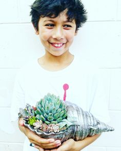 """Me: """"Hey you, come hold my shell and take a picture""""  Him: """"ok mom whatever you want""""   Best son ever!   #maui #shellshocked #instagood #wildhairhedontcare"""
