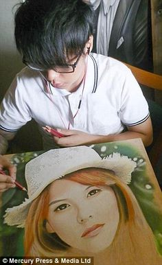 Mr Hoo works on a portrait of a young woman...