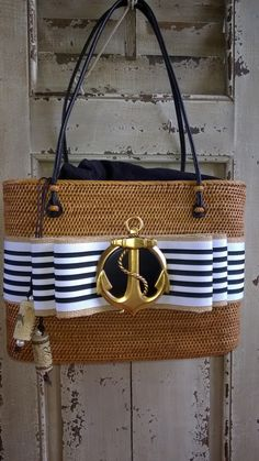 Spring 2015 is here! Anchors Away...hand woven bag with an interchangeable bow...One bag is all you need! $219 at www.elizabethjamiesondesigns.com