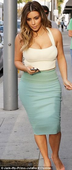 Glossy locks: Kim showed off her healthier looking hair as she stepped out in Beverly Hills on Monday